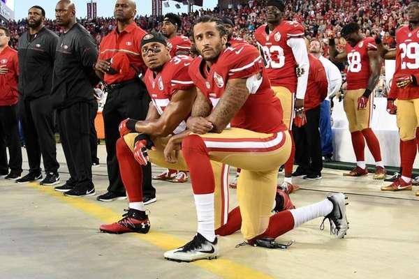 Colin Kaepernick, right, and Eric Reid of the
