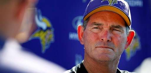 Minnesota Vikings coach Mike Zimmer speaks to reporters