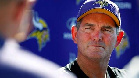 Minnesota Vikings coach Mike Zimmer speaks to reporters
