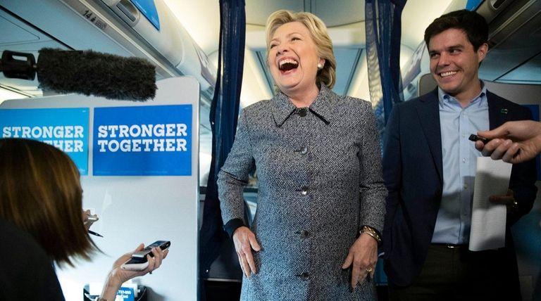 Hillary Clinton and press secretary Nick Merrill talk
