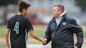 Brentwood head coach Ron Eden congratulates Bryan Argueta