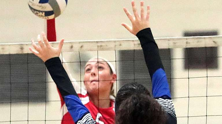 Smithtown East's Haley Anderson (5) spikes the ball