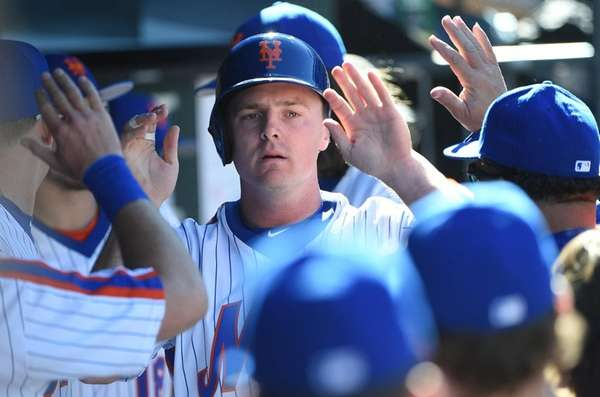 New York Mets rightfielder Jay Bruce is greeted