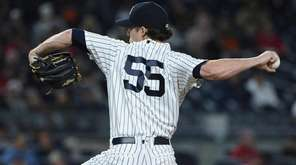 New York Yankees starting pitcher Bryan Mitchell delivers