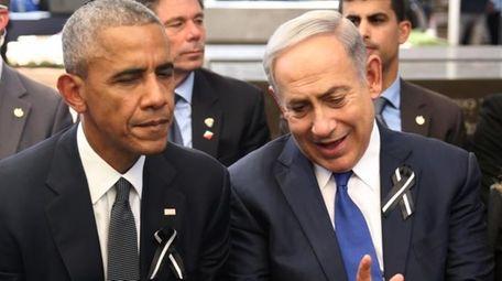 Israeli Prime Minister Benjamin Netanyahu, right, talks with