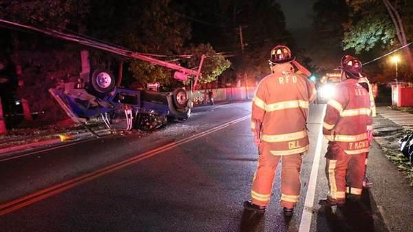 A tow truck overturned on Hawkins Avenue in