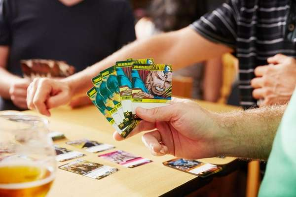 Patrons play a card game at Destination Unknown