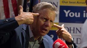 Libertarian presidential candidate Gary Johnson gestures he speaks