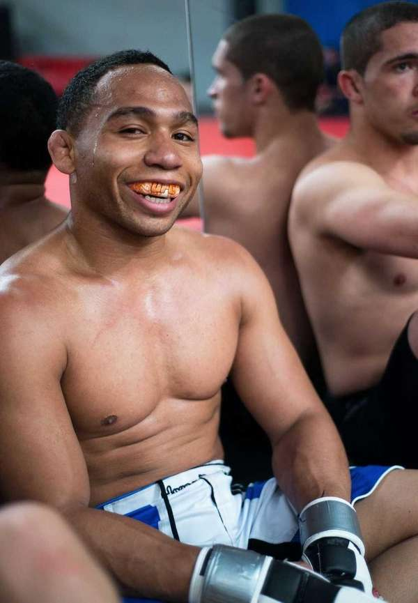 John Dodson poses during a media event at