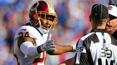 Josh Norman #24 of the Washington Redskins argues