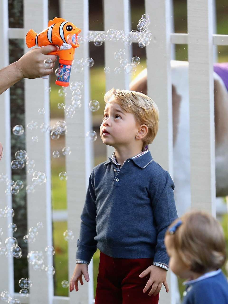 Prince George attends a children's party for Military