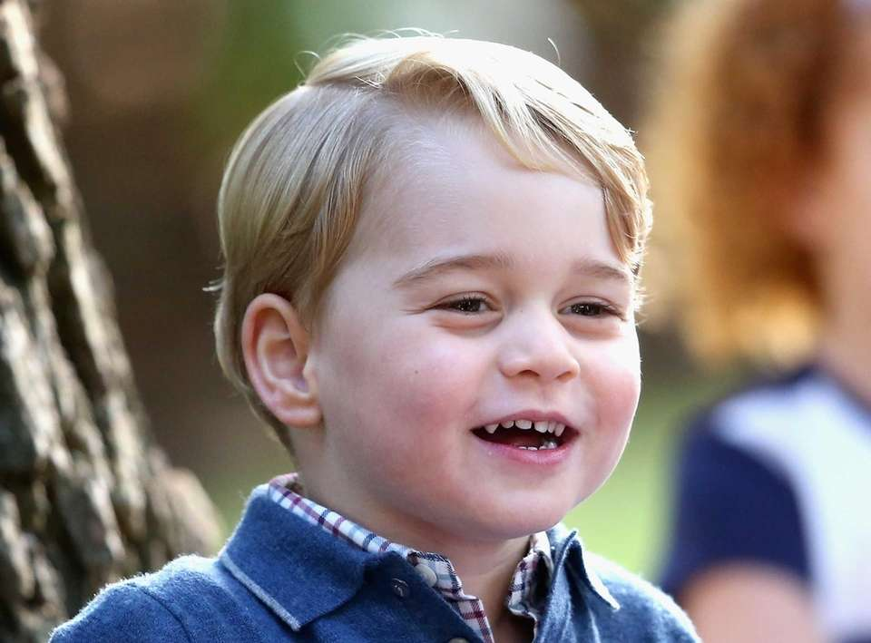 Prince George plays with bubbles at a children's