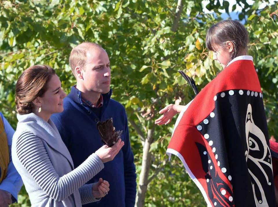 Kate, Duchess of Cambridge, holds an eagle feather