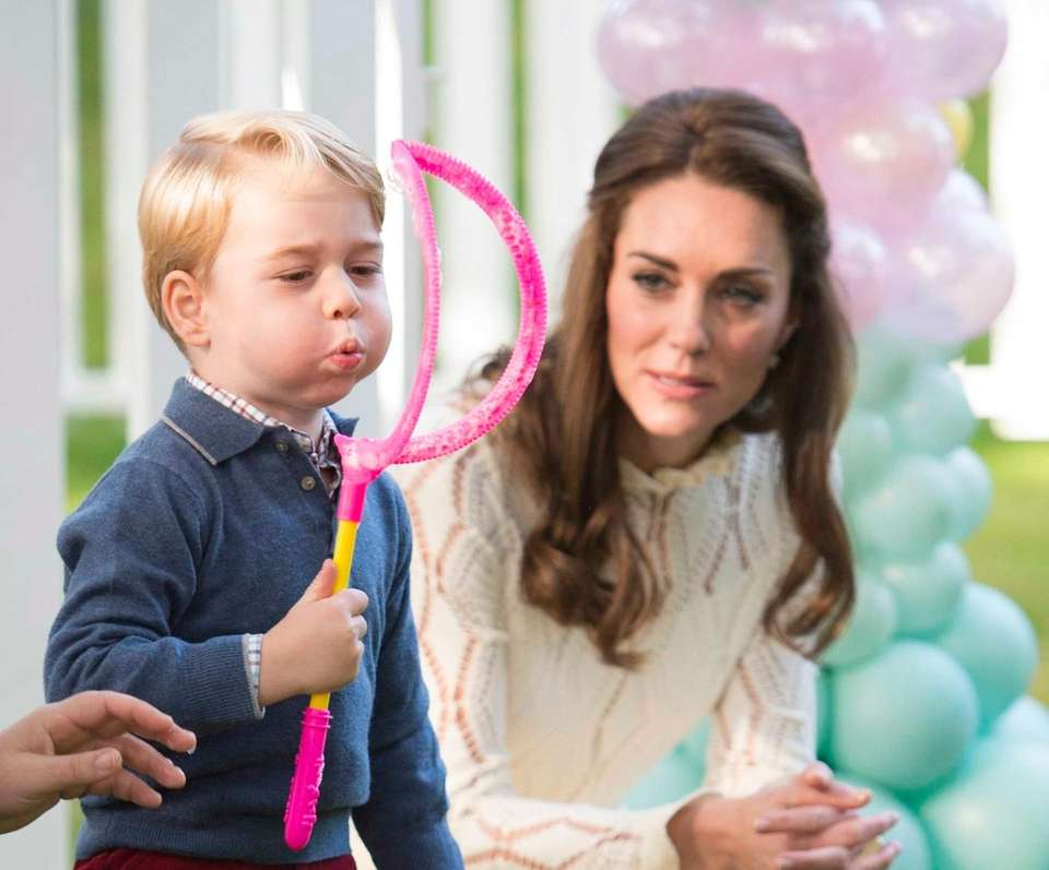 Catherine, Duchess of Cambridge and Prince George attend