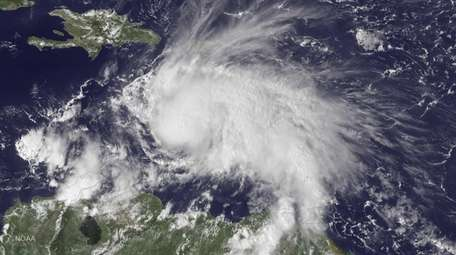 This NOAA GOES East satellite image released Friday,