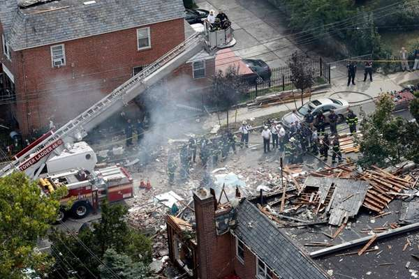 Emergency service personnel work at the scene of