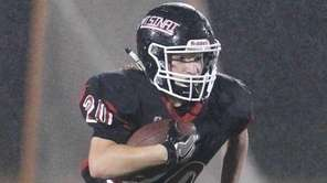 Mt Sinai's Joseph Pirreca picks up some yards