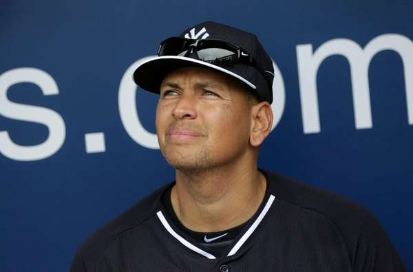 Alex Rodriguez sits in the Yankees' dugout during