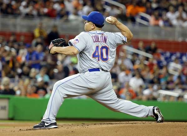 New York Mets' starting pitcher Bartolo Colon throws