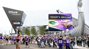 Fans enter U.S. Bank Stadium before the