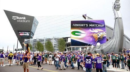 Fans enter U.S. Bank Stadium before the