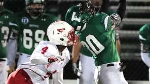 Farmingdale's Jordan Mclune tries to hold onto a