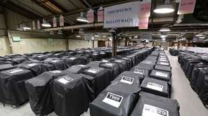 Rows of electronic voting machines are stored at