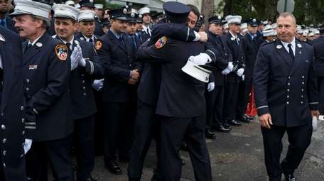 Firefighters arrive for the funeral of FDNY Deputy