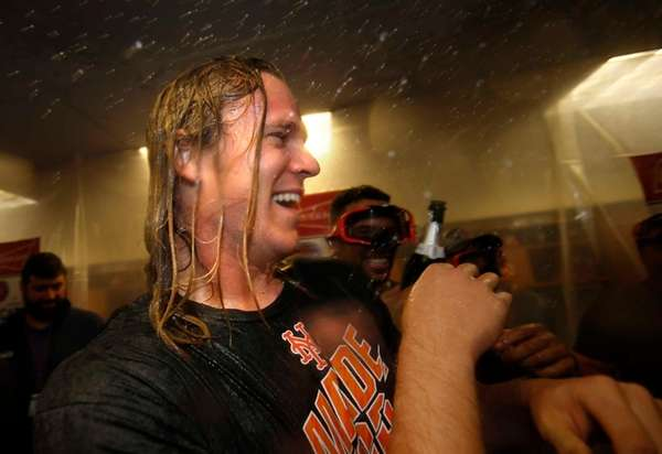 New York Mets' pitcher Noah Syndergaard is doused