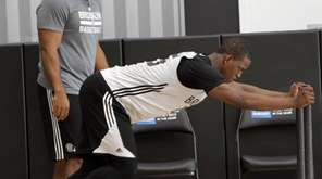 Brooklyn Nets' Isaiah Whitehead completes an exercise routine