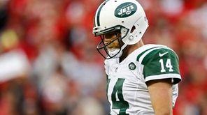 Jets' quarterback Ryan Fitzpatrick walks off the field