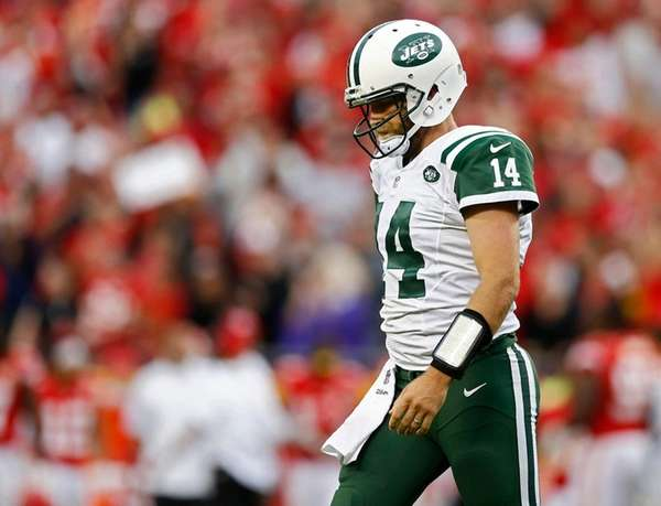 Jets' quarterback Ryan Fitzpatrick walks off the field