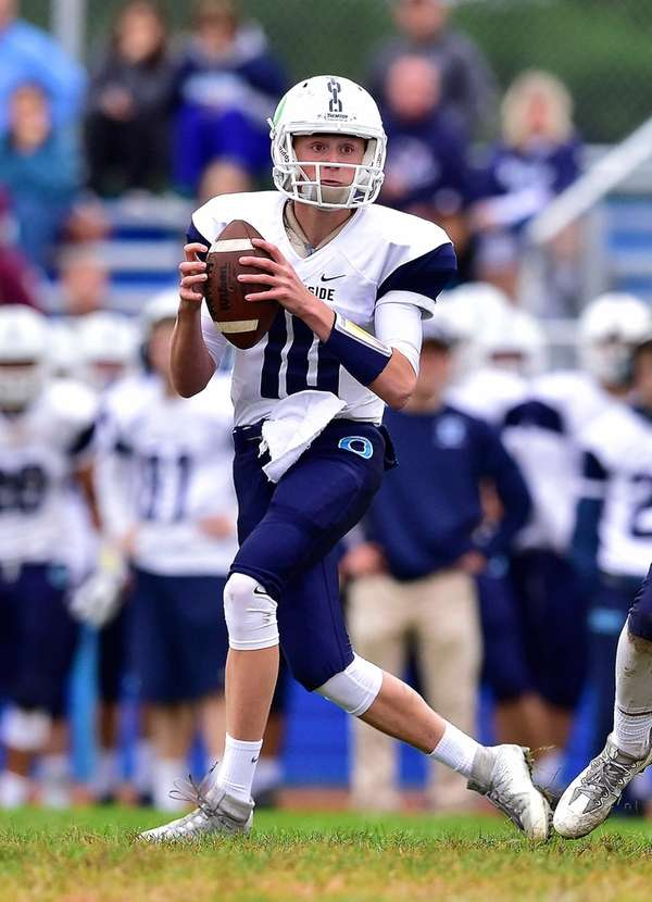 Oceanside quarterback Tommy Heuer looks to pass against