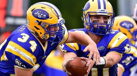 East Meadow running back Mike Dolley takes the
