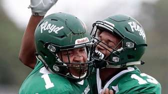 William Floyd's AJ Ray, right, congratulates Mack Driver,