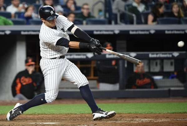 New York Yankees catcher Austin Romine hits a