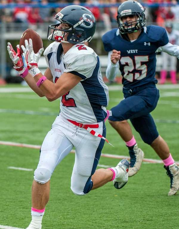 Smithtown East's Anthony Voelker, left, makes a catch