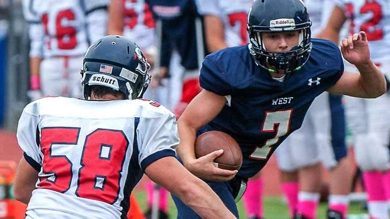 Smithtown East's Peter Forgione, left, goes for a