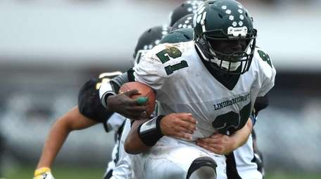 Lindenhurst's Andy Merkerson powers through for a touchdown