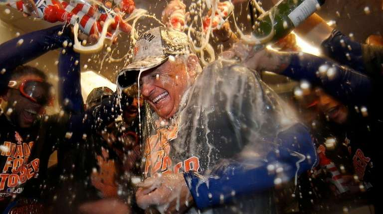 New York Mets' manager Terry Colllins is doused