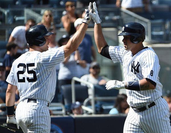 New York Yankees' first baseman Mark Teixeira greets