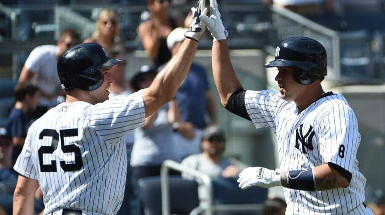 New York Yankees' first baseman Mark Teixeira greets