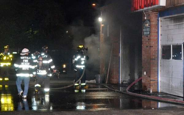 Firefighters put out a blaze at Nick's Auto