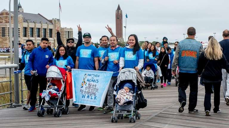 Supporters walk during the 2016 Autism Speaks Walk,