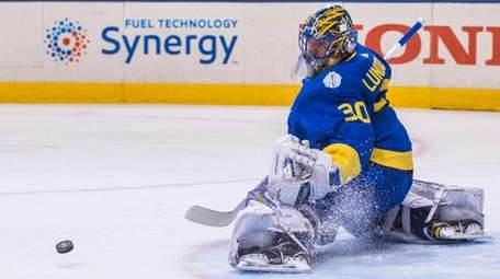 Henrik Lundqvist makes a save for Team Sweden