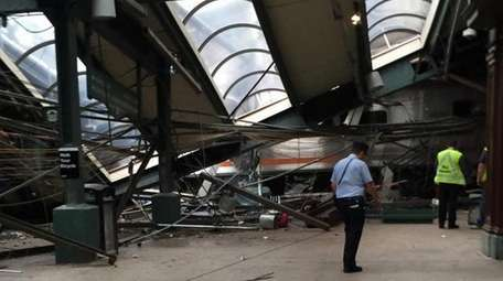 Wreckage at the Hoboken, N.J. rail station is