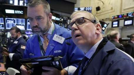 Traders Kevin Lodewick, left, and Richard Cohen work