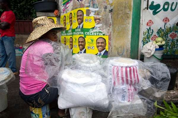 A street seller sits next to her goods,