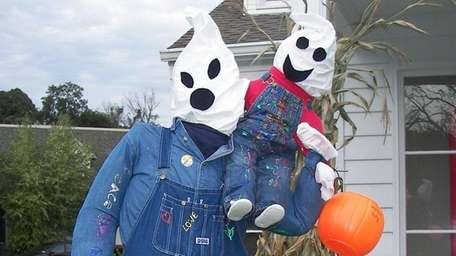 Thirty scarecrows line the paths of Stony Brook