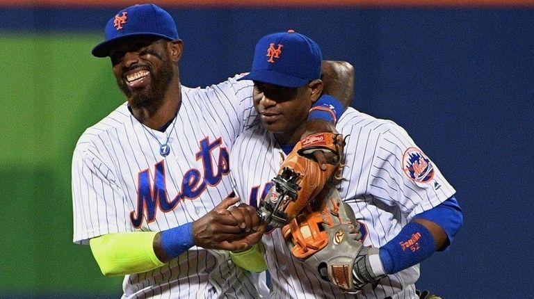 Mets third baseman Jose Reyes and leftfielder Yoenis